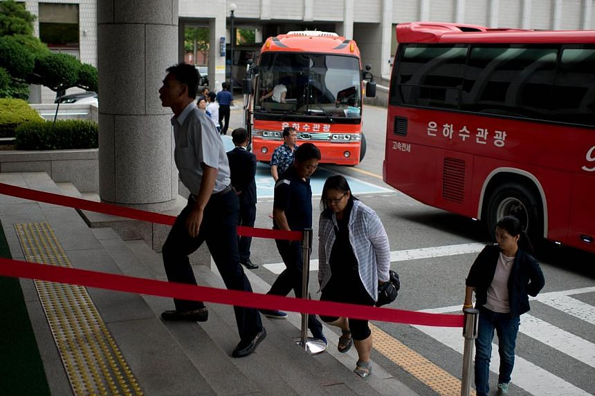 Relatives of victims of the Sewol ferry arrive at Gwangju district court on July 8, 2014. -- PHOTO: AFP