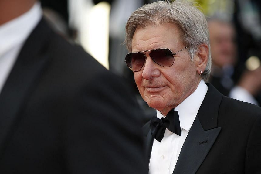 "Member of the cast of ""The Expendables 3"", US actor Harrison Ford poses on the red carpet during the 67th edition of the Cannes Film Festival in Cannes, southern France, on May 18, 2014. Actor Harrison Ford is recuperating from surgery after bre"