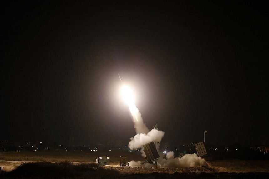 An Iron Dome launcher fires an interceptor rocket in the southern Israeli city of Ashdod July 8, 2014.At least five rockets fired from Gaza were shot down over Tel Aviv and the surrounding area on Wednesday, army radio said. -- PHOTO: REUTERS