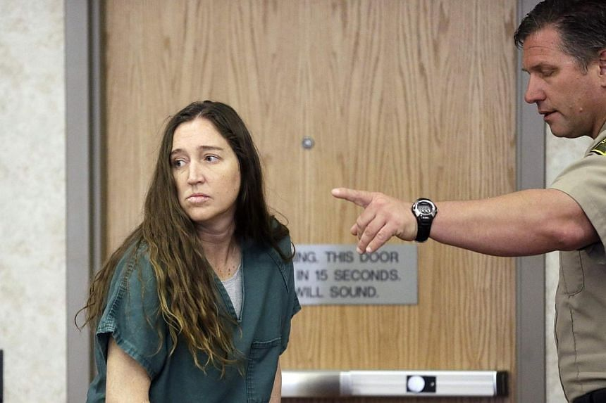 Megan Huntsman, accused of killing six of her babies and storing their bodies in her garage, appears in court in Provo, Utah, April 28, 2014. -- PHOTO: REUTERS