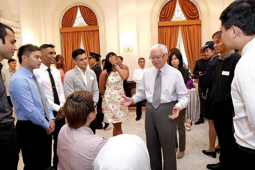 President Tony Tan Keng Yam (centre) hosted a tea reception at the Istana on Wednesday, July 9, 2014, afternoon for more than 40 young people, as part of Youth Day celebrations. -- ST PHOTO: CHEW SENG KIM