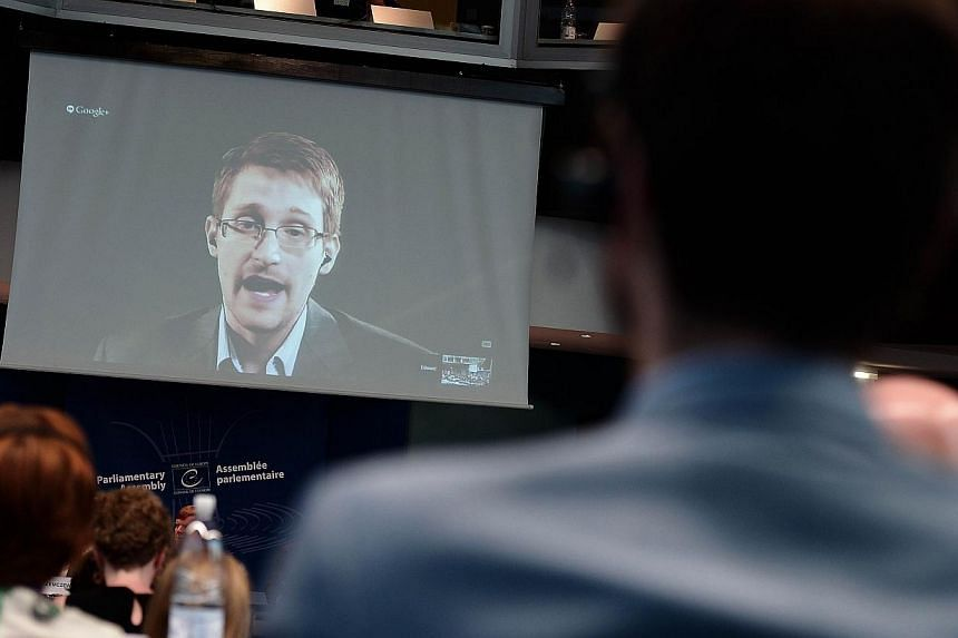US National Security Agency (NSA) whistleblower Edward Snowden speaks to European officials via videoconference during a parliamentary hearing on improving the protection of whistleblowers, at the Council of Europe in Strasbourg, eastern France on Ju