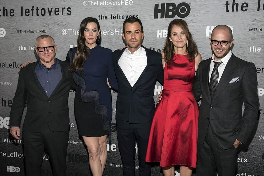 The Leftovers creator Tom Perrotta (left) with actors Liv Tyler, Justin Theroux, Amy Brenneman and co-creator Damon Lindelof. -- PHOTO: REUTERS