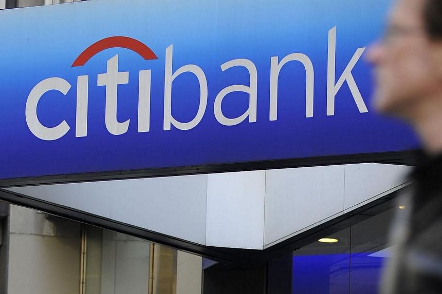 A man walks by a Citibank branch at the US bank Citigroup world headquarters on Park Avenue, in New York, in this Nov 17, 2008 file photo.Citigroup is close to paying about US$7 billion (S$8.7 billion) to resolve a US probe into whether it defr