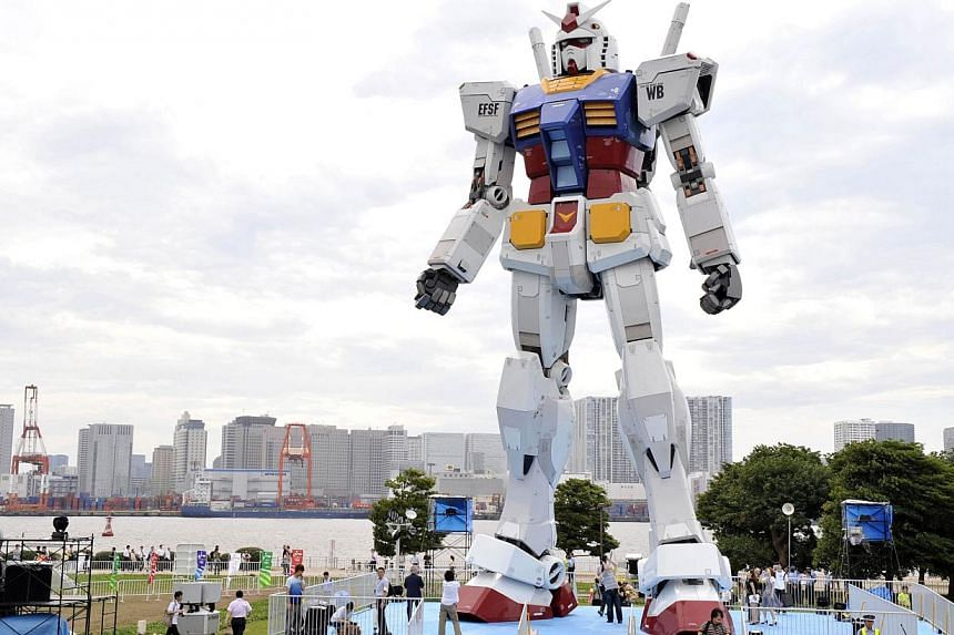 This file picture taken on July 10, 2009 shows an 18-metre tall statue of popular TV animation hero, Gundam, at a Tokyo park. A team of Japanese animators and engineers on July 9, 2014 unveiled plans to build a moving 18-metre tall Gundam robot, in a