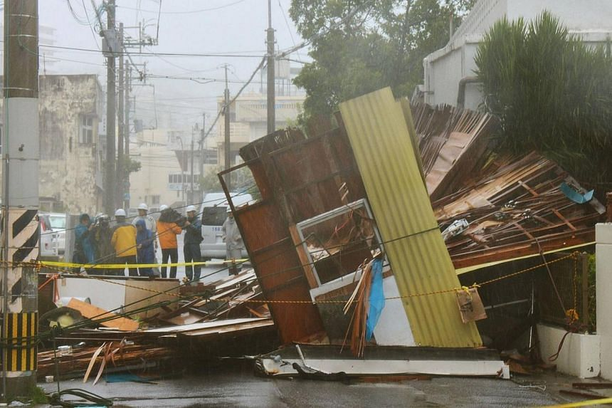 A wooden house which collapsed due to strong winds caused by Typhoon Neoguri is seen in Naha, on Japan's southern island of Okinawa, in this photo taken by Kyodo July 8, 2014. -- PHOTO: REUTERS