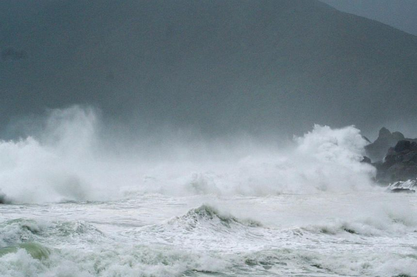Waves crash as Typhoon Neoguri approaches the region at Wase beach at Amami Oshima, Kagoshima prefecture, in this photo taken by Kyodo July 8, 2014. -- PHOTO: REUTERS
