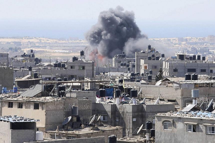 Smoke and flames are seen following what Palestinian witnesses said was an Israeli air strike in Rafah in the southern Gaza Strip on July 10, 2014. UN chief Ban Ki-moon appealed Thursday for a ceasefire between Israel and Palestinian militants, calli