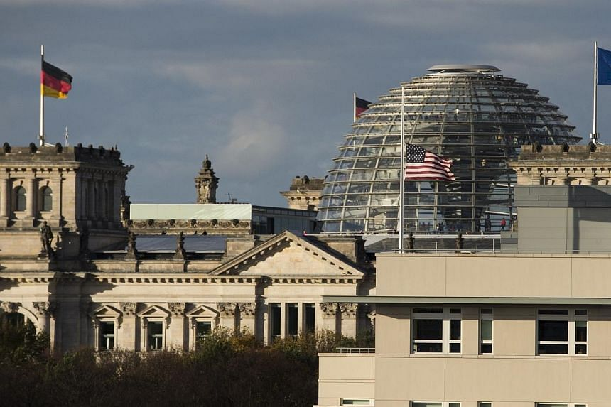 This photo taken on Oct 29, 2013 shows a view of the US embassy in front of Berlin's Parliament building (the Reichstag).Germany has expelled the US intelligence station chief in Berlin Thursday, July 10, 2014, over alleged spying by Washington
