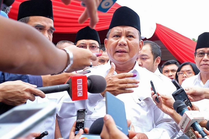 Indonesian presidential candidate Prabowo Subianto speaks to the media after voting at a polling station in the village of Bojong Koneng in Bogor, West Java province on July 9, 2014. -- PHOTO: AFP
