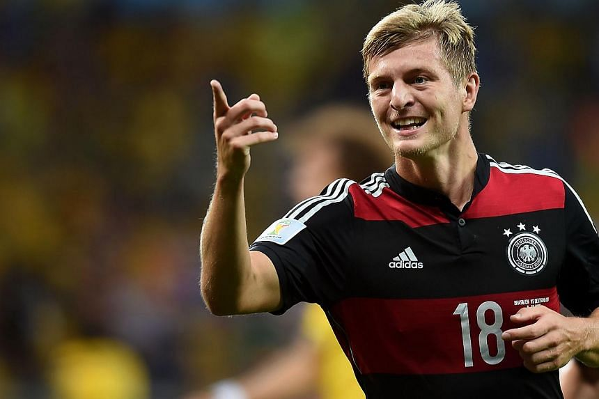 Germany's midfielder Toni Kroos celebrates after scoring during the semi-final football match between Brazil and Germany at The Mineirao Stadium in Belo Horizonte during the 2014 FIFA World Cup on July 8, 2014. -- PHOTO: AFP