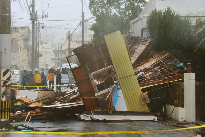 A wooden house which collapsed due to strong winds caused by Typhoon Neoguri is seen in Naha, on Japan's southern island of Okinawa, in this photo taken by Kyodo on July 8, 2014. -- PHOTO: REUTERS