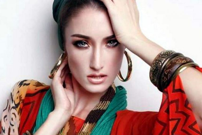 Two men have been remanded by the Kota Tinggi court in connection with the death of Estonian model Regina Soosalu on Pulau Rawa off Mersing on July 1. -- PHOTO: THE STAR/ASIA NEWS NETWORK