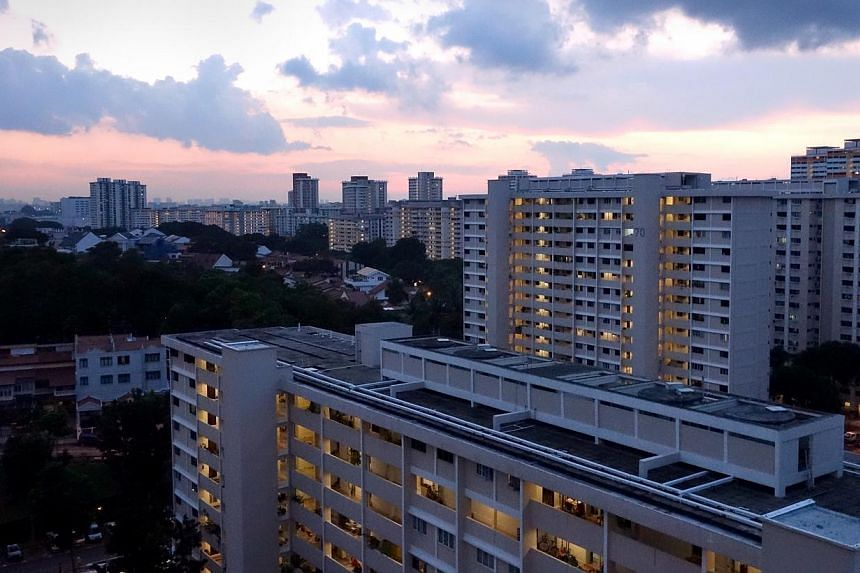 Bedok South HDB estate at dusk. Resale prices for Housing Board flats dropped for the fifth consecutive month in June, hitting yet another two-year low since April 2012. -- PHOTO: ST FILE