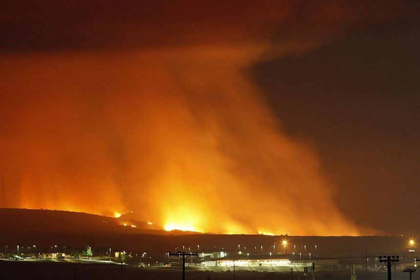 The Las Pulgas Fire lights the night on May 16, 2014 at Camp Pendleton, California. Investigators have determined that it was a youth who intentionally started a destructive fire that teared through southern California in May, destroying dozens of ho