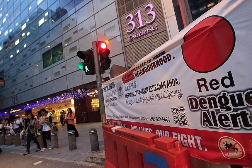 The exterior view of 313 Somerset and a banner showing the red dengue alert. After over 20 years of intensive research, a French pharmaceutical company has announced that its dengue vaccine can reduce dengue haemorrhagic fever cases by 88.5 per cent.
