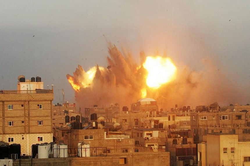 A ball of fire is seen following an early morning Israeli air strike on July 11, 2014, on Rafah in the southern of Gaza strip.Israel could be violating the laws of war by bombing Palestinian homes in Gaza, the UN's human rights office said Frid