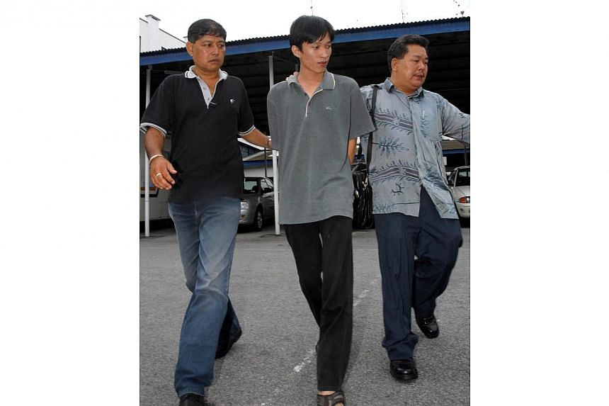Penang-born Took Leng How, 22, surrendered himself to the Penang police on Saturday 30 Oct 2004. He will be charged with murder. -- PHOTO: GUANG MING DAILY