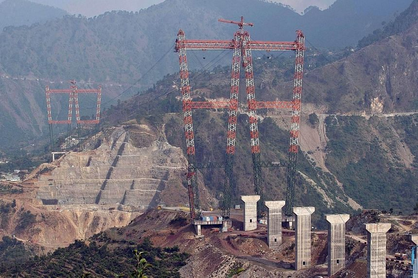 This photograph taken on July 5, 2014, shows a general view of the site of the under-construction world's highest railway bridge over the Chenab river in Kauri in northern Jammu and Kashmir state. -- PHOTO: AFP