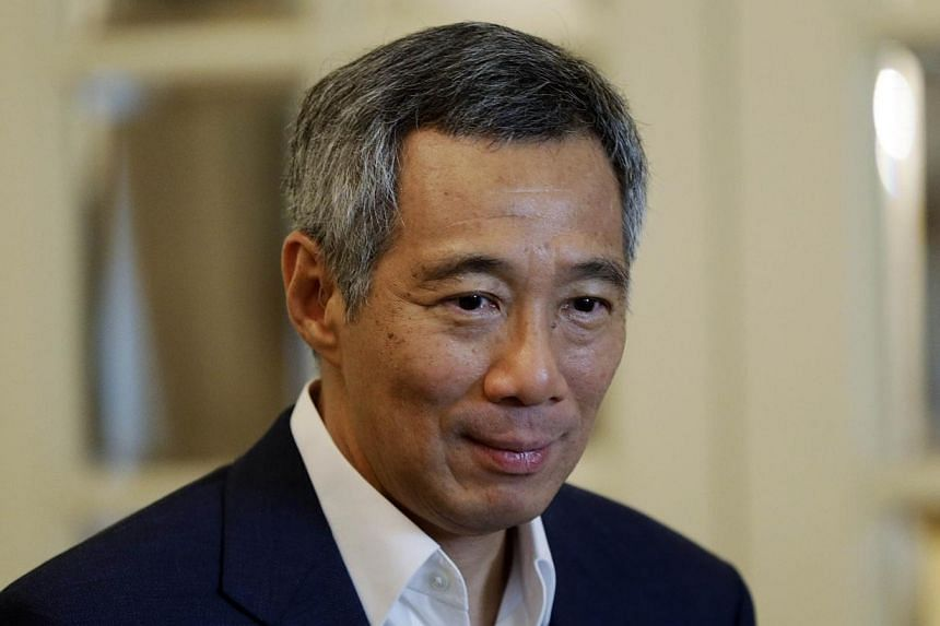 Prime Minister Lee Hsien Loong has made an application for the High Court to rule in his favour in his defamation suit against blogger Roy Ngerng, without going through a full trial. -- PHOTO: AFP
