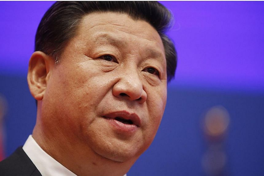 China's President Xi Jinping addresses the Joint Opening Session of the US-China Strategic and Economic Dialogue at the Diaoyutai State Guesthouse in Beijing on July 9, 2014. Mr Xi will stop off in Greece on his way to South America next week, the go