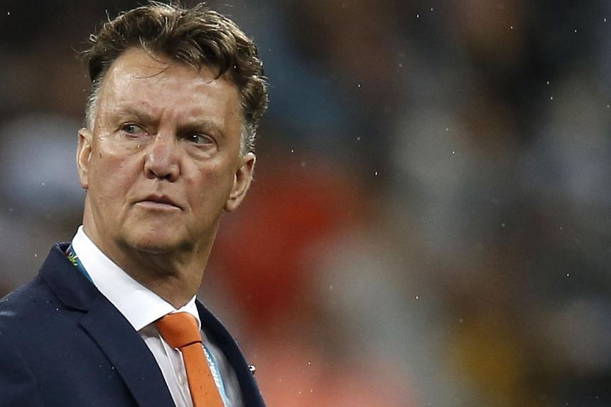 Netherlands' coach Louis van Gaal reacts after the semi-final football match between Netherlands and Argentina of the Fifa World Cup at The Corinthians Arena in Sao Paulo on July 9, 2014. -- PHOTO: AFP