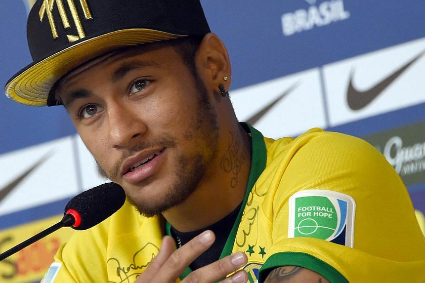 Brazil's forward Neymar gestures during a press conference in Teresopolis on July 10, 2014, during the Fifa World Cup. Brazil forward Neymar has done the unpredictable once again by revealing he will support Brazil's biggest rivals Argentina in Sunda