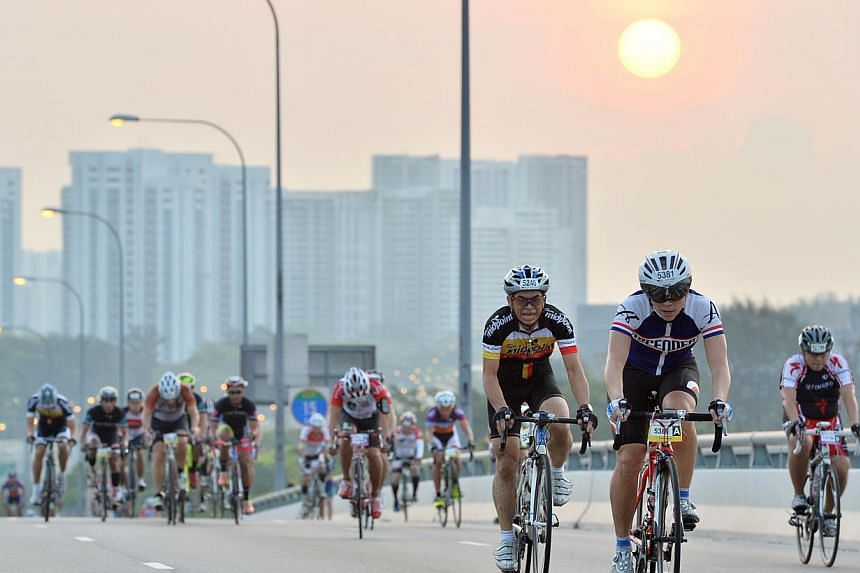 Cyclists cycling up Benjamin Sheares Bridge at the sixth edition of the OCBC Cycle Singapore at the F1 Pit Building on 30 March 2014.Local bank OCBC is still committed to holding a premier cycling event here, even as it recently terminated its