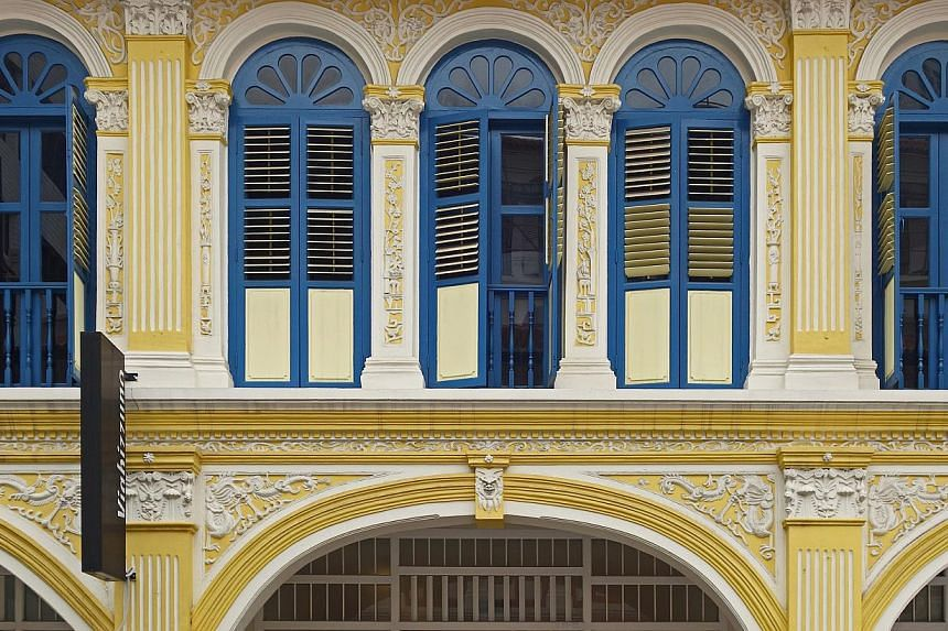 Windows of shophouses in Petain Road and the facade of Chinese Baroque shophouse in Purvis Street (above) showcase different architectural styles. -- PHOTO: DR JULIAN DAVISON