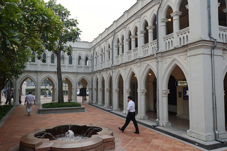 The late war heroine Elizabeth Choy is one of the eight women featured on this tour, which takes in landmarks such as Chijmes (above). -- PHOTO: ST FILE