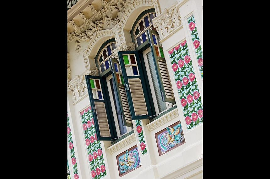 Windows of shophouses in Petain Road (above) and the facade of Chinese Baroque shophouse in Purvis Street showcase different architectural styles. -- PHOTO: NATIONAL HERITAGE BOARD