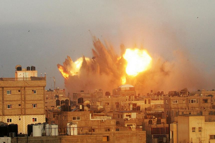A ball of fire is seen following an early morning Israeli air strike, on July 11, 2014, on Rafah in the southern of Gaza strip. Singapore is concerned about the escalating violence in the Middle East and calls on all sides to work towards a ceasefire