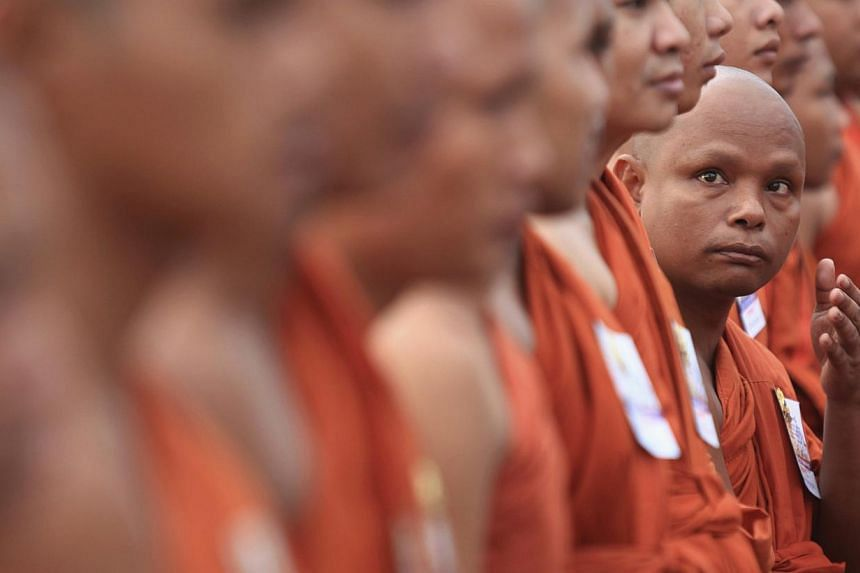 Buddhist monks attend a ceremony in front of the Royal Palace in Phnom Penh on July 11, 2014. -- PHOTO: REUTERS