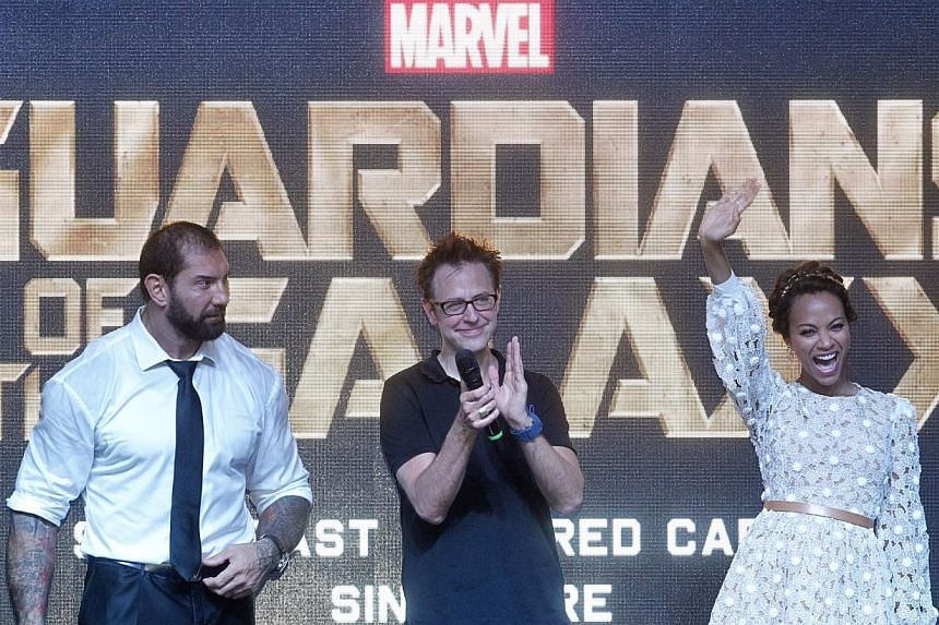 Actor Dave Bautista, director James Gunn and actress Zoe Saldana greeting fans from the stage at Shaw House on July 12, 2014. -- ST PHOTO: KEVIN LIM