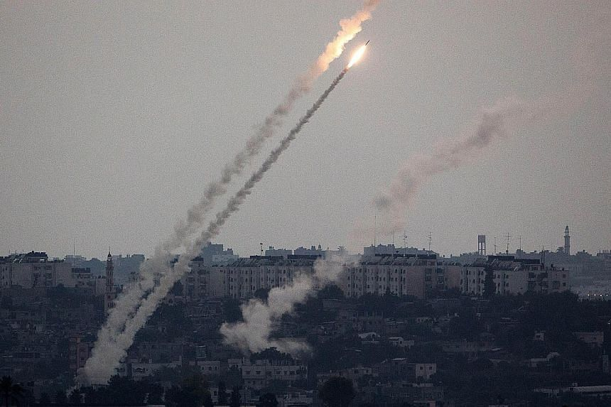 A picture taken from the southern Israeli Gaza border shows a rocket being launched from the Gaza strip into Israel, on July 11, 2014. The United States said on Friday that it was ready to leverage its relationships in the Middle East to try to