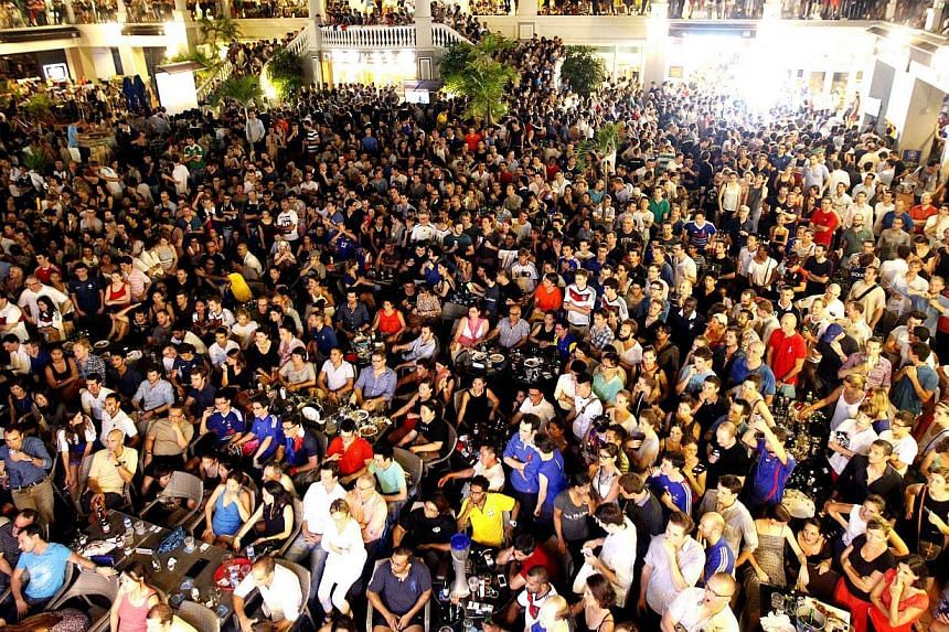 Fans watching the World Cup quarter-finals last week at Robertson Walk, a favourite spot for expatriates to enjoy the live screenings of the matches. To secure a good viewing spot, show up early.