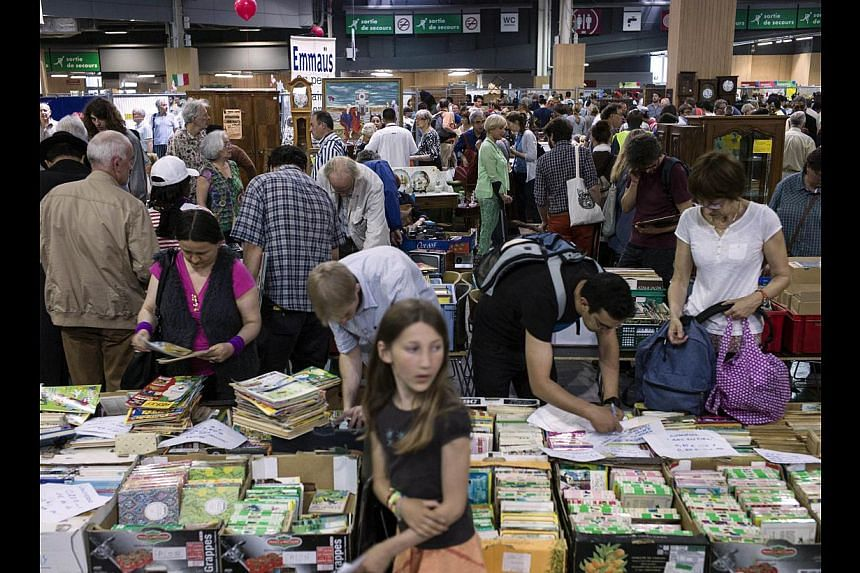 People looking at books on sale in Paris recently. The French say they trust books more than any other medium, including television and newspapers.