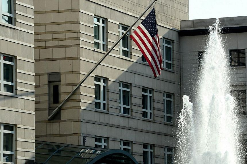 The US national flag is displayed outside the building of the US embassy in Berlin on July 10, 2014. -- PHOTO: AFP