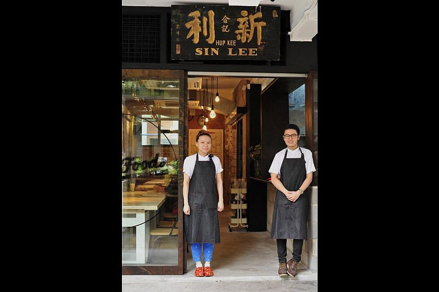 Sin Lee Hup Kee coffee shop was turned into Sin Lee Foods, and its owners Mr Sean Lim and Ms Jerraldine Chen (both above) have retained its signboard. -- PHOTO: DIOS VINCOY JR FOR THE SUNDAY TIMES