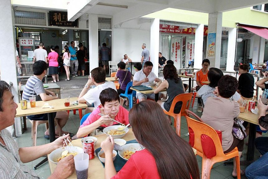 Sin Lee Hup Kee coffee shop (above) was turned into Sin Lee Foods, and its owners Mr Sean Lim and Ms Jerraldine Chen have retained its signboard. -- PHOTO: LIANHE WANBAO