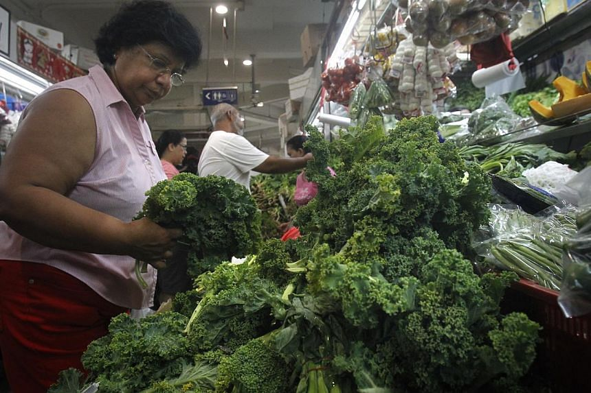 Stalls in Tekka Centre are offering kale (above), endives and salad leaves. -- ST PHOTO: KEVIN LIM