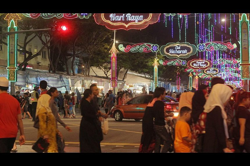 The Hari Raya bazaar in Geylang Serai offers more than just festival wares. Stalls such as Chubby Churros selling the Spanish snack, Mama Coconut selling ice cream and drinks, and Soulhunterz Haunted House are doing good business too. -- ST PHOTO: SE