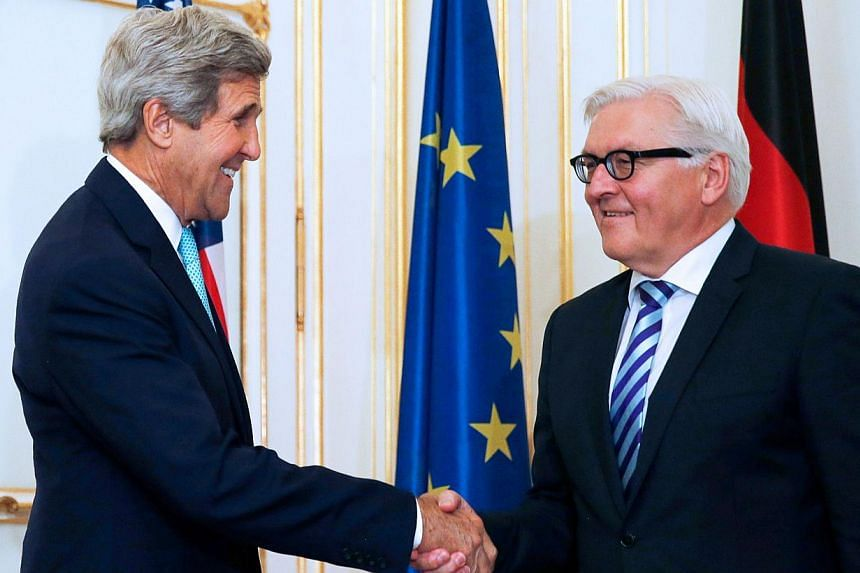 US Secretary of State John Kerry (left) shakes hand with German Foreign Minister Frank-Walter Steinmeier before a bilateral meeting, as part as talks between the foreign ministers of the six powers negotiating with Tehran on its nuclear program, in V