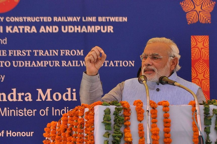 Indian Prime Minister Narendra Modi speaks during the inauguration ceremony at Katra railway station in Katra, about 45km from Jammu, on July 4, 2014. -- PHOTO: AFP