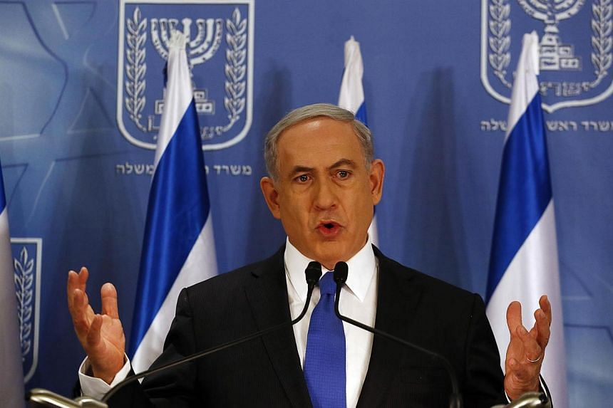 Israeli Prime Minister Benjamin Netanyahu gestures as he speaks during a news conference at the defence ministry in the Israeli coastal city of Tel Aviv on July 11, 2014.Israeli Prime Minister Benjamin Netanyahu warned on Sunday that any nuclea