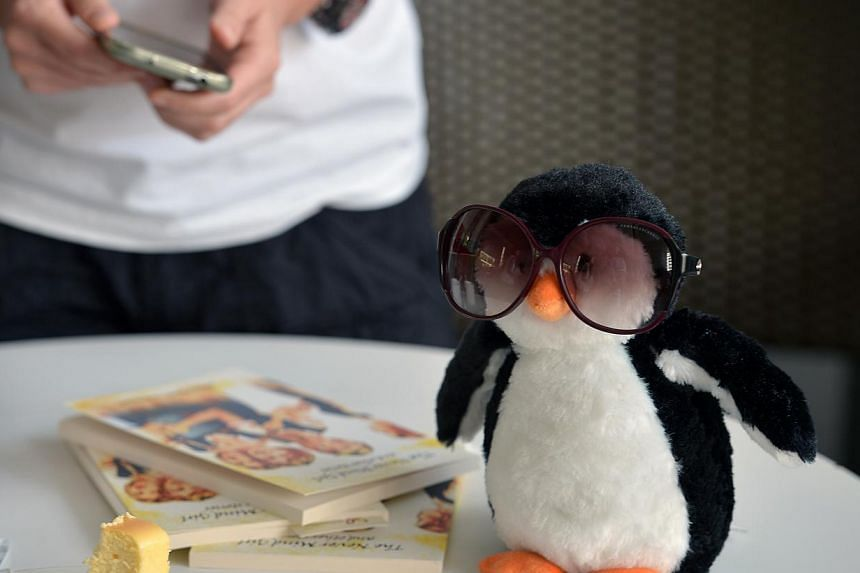 Participants to the event were invited to bring along a stuffed penguin.-- ST PHOTO:KUA CHEE SIONG