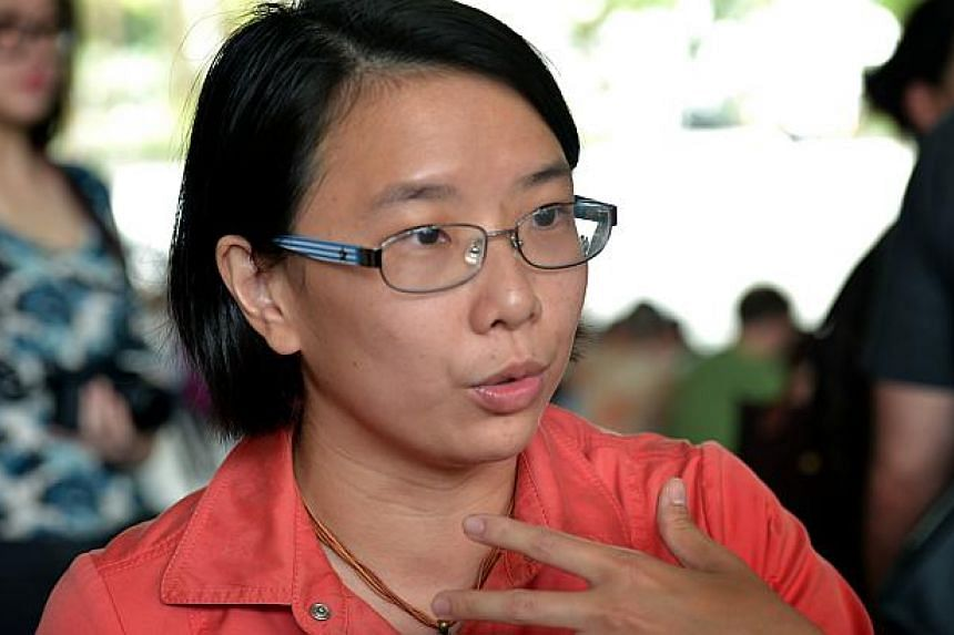 """The event was organised by local writer Jolene Tan (above) and Ms Germaine Ong, two mothers, whose aim was to make a """"peaceful statement"""" about how adults and children both enjoy reading.-- ST PHOTO:KUA CHEE SIONG"""
