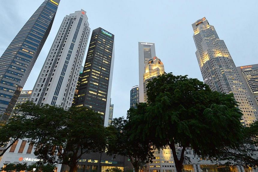 The CBD skyline on June 05 2014. Lacklustre activity at Singapore's factories dragged the economy's growth down to 2.1 per cent in the second quarter over a year ago, the Ministry of Trade and Industry said on Monday. -- PHOTO: ST FILE