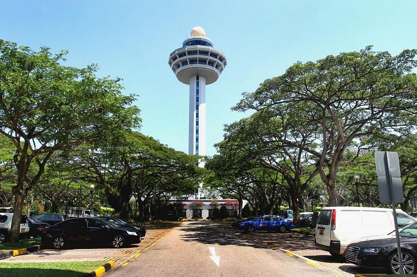 The control tower is seen from the open-air carpark of Terminal One of Changi Airport.Changi Airport has upgraded its Weekend Escapades mobile app to give users more ideas and choices. -- PHOTO: ST FILE