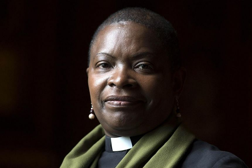 Rose Hudson-Wilkin, chaplain to Queen Elizabeth II and the Speaker of the House of Commons, poses for a photograph during an interview with AFP in London on July 9, 2014. The Church of England could vote to allow female bishops for the first tim